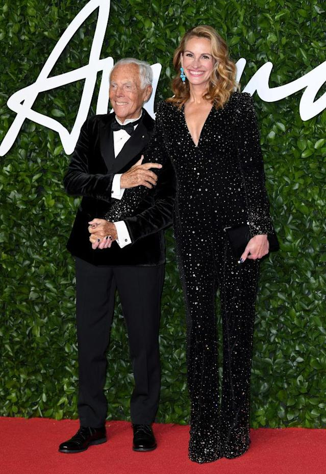 Julia Roberts was joined on the red carpet by Georgio Armani and kept it chic in a classic sparkly jumpsuit [Photo: Getty]