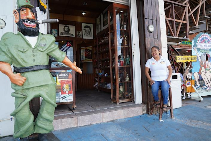 "Customers are scarce at the Cuban cigar shop where Ofelia Cruz, 37, a mother of two, works in Cozumel, Mexico. The shop was a magnet for cruise passengers before the pandemic. <span class=""copyright"">(Liliana Nieto del Rio / For The Times)</span>"