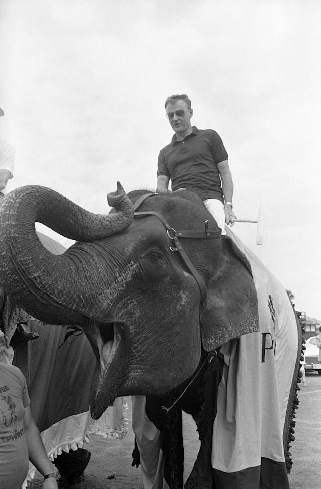 <p>Zbigniew Brzezinski, former National Security Advisor under Pres. Jimmy Carter, demonstrates his form after being shown how to play polo Indian style on an elephant, April 15, 1984, West Palm Beach, Fla. The demonstration was a prelude to the Piaget World Cup Polo Match. (Photo: Ray Fairall/AP) </p>