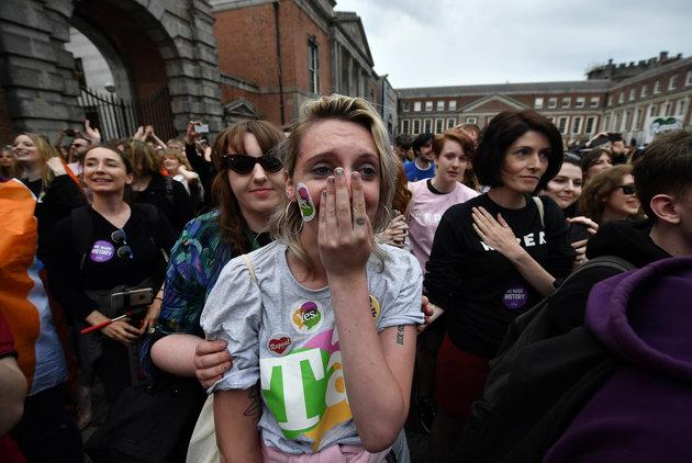A 'Yes' voter breaks down in tears as the results are announced