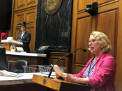Julia Vaughn, executive director of Common Cause Indiana, speaks during a legislative redistricting hearing as Republican Rep. Tim Wesco, chairman of the Indiana House Elections Committee, looks on at the Indiana Statehouse in Indianapolis on Aug. 11, 2021. (AP Photo/Tom Davies)
