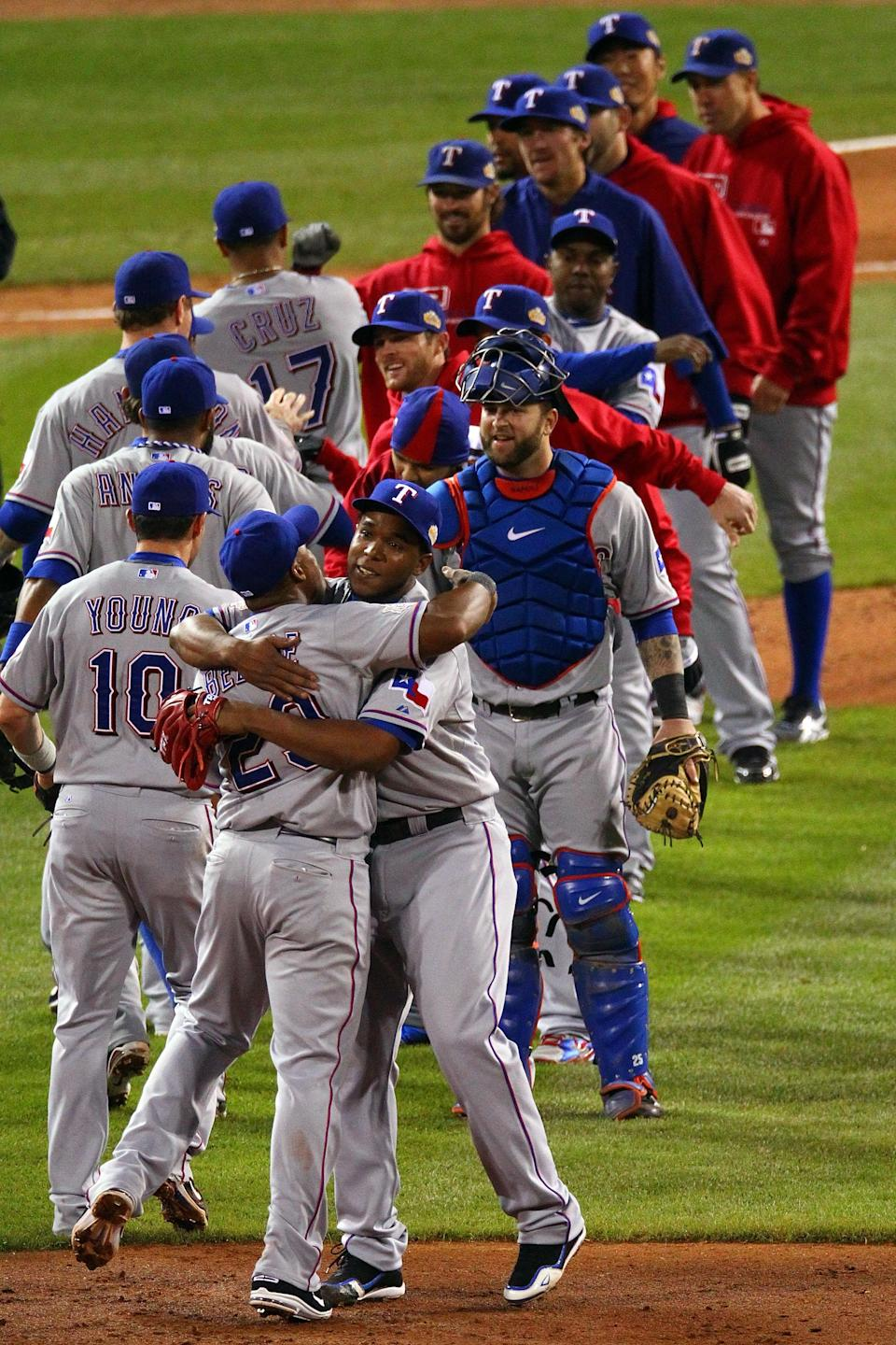 ST LOUIS, MO - OCTOBER 20: Adrian Beltre #29 and Neftali Feliz #30 of the Texas Rangers celebrate after defeating the St. Louis Cardinals 2-1 during Game Two of the MLB World Series at Busch Stadium on October 20, 2011 in St Louis, Missouri. (Photo by Dilip Vishwanat/Getty Images)