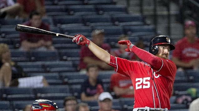 Washington Nationals first baseman Adam LaRoche follows through on a solo home run in the fourth inning of a baseball game against the Atlanta Braves early Sunday, Aug. 10, 2014, in Atlanta. (AP Photo/John Bazemore)