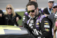 FILE - In this Feb. 16, 2020 file photo Jimmie Johnson climbs intp his car before the NASCAR Daytona 500 auto race at Daytona International Speedway in Daytona Beach, Fla. NASCAR seven-time champion Jimmie Johnson will test an Indy car next week on the road course at Indianapolis Motor Speedway. Hes long said he is open to racing in the series but did not want to compete on ovals out of safety concerns. On Friday, July 3, 2020, he indicated recent safety improvements have softened his stance and the Indianapolis 500 is not entirely out of the picture.(AP Photo/John Raoux, File)