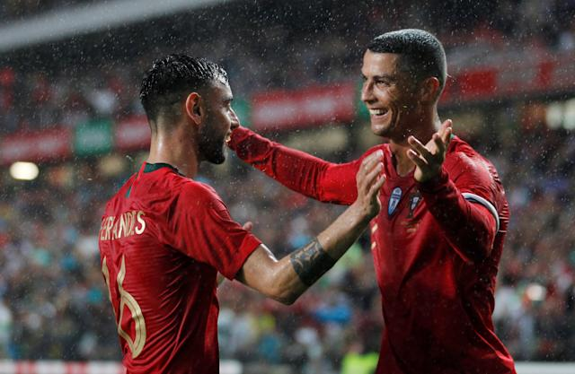 Soccer Football - International Friendly - Portugal vs Algeria - Estadio da Luz, Lisbon, Portugal - June 7, 2018 Portugal's Bruno Fernandes celebrates with Cristiano Ronaldo after scoring their second goal REUTERS/Rafael Marchante TPX IMAGES OF THE DAY