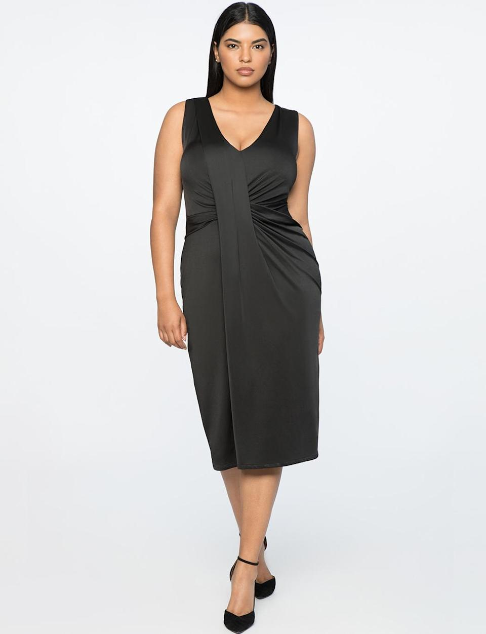 """<p>This draped dress is also available in black, which creates a more svelte aesthetic. You can wear it at a holiday cocktail party or on a date night. Just add a dash of red lipstick to brighten up your look. <br>Drape-front V-neck dress in black, $100, <a rel=""""nofollow noopener"""" href=""""https://fave.co/2zkGB4F"""" target=""""_blank"""" data-ylk=""""slk:eloquii.com"""" class=""""link rapid-noclick-resp"""">eloquii.com</a> </p>"""