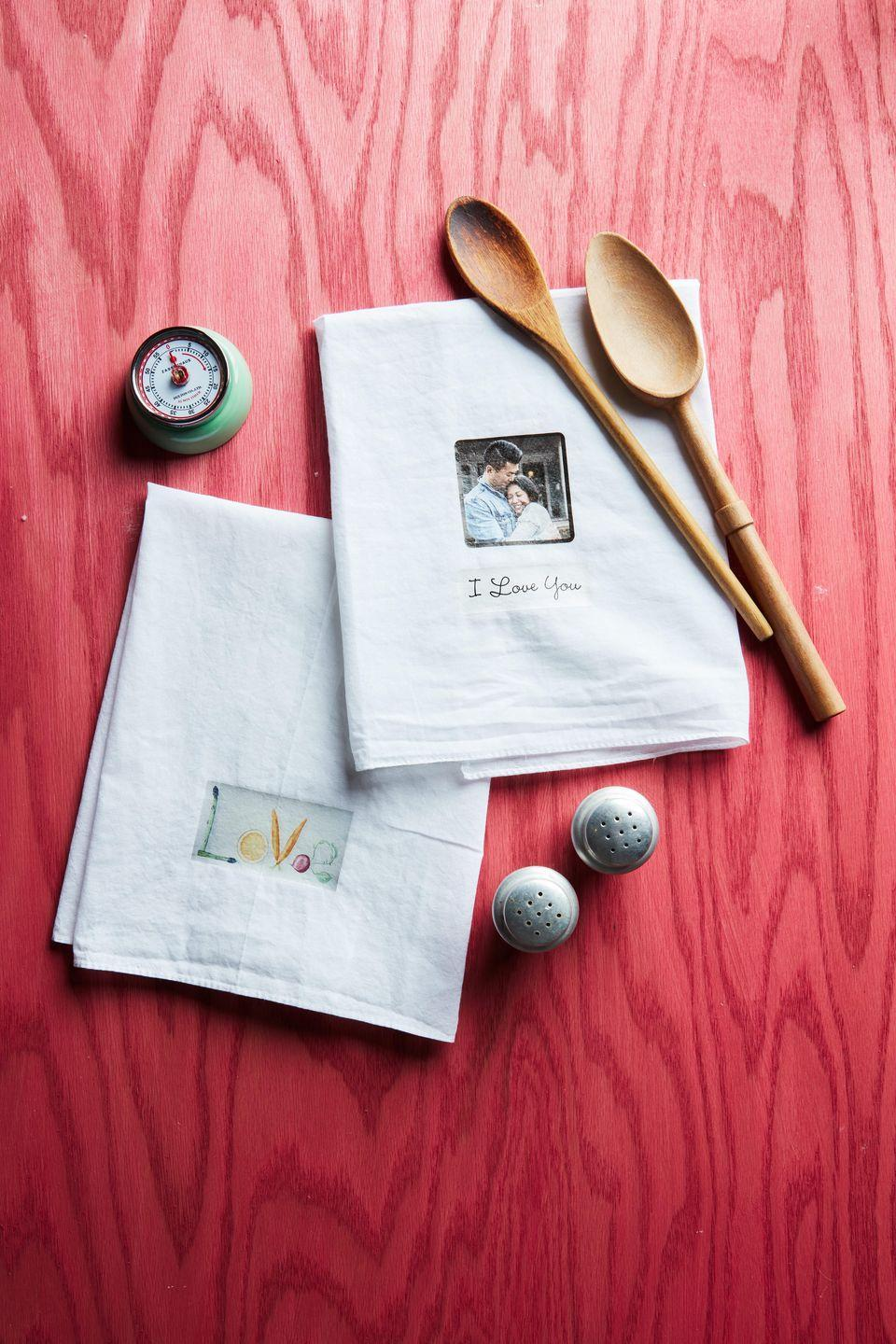 """<p>Beautiful and utilitarian, these custom dishtowels will bring love and joy to the most used room in the house—the kitchen. </p><p><strong>To make:</strong> On your computer, design imagery including photographs, if desired. Print on iron-on transfer paper. Cut out around imagery and iron on cotton dishtowels per manufacturer's directions.</p><p><a class=""""link rapid-noclick-resp"""" href=""""https://www.amazon.com/TransOurDream-Tru-Transfer-EasyToUse-Transfer-Printable/dp/B08CN3N48H/ref=sr_1_2_sspa?tag=syn-yahoo-20&ascsubtag=%5Bartid%7C10050.g.2971%5Bsrc%7Cyahoo-us"""" rel=""""nofollow noopener"""" target=""""_blank"""" data-ylk=""""slk:SHOP IRON-ON PAPER"""">SHOP IRON-ON PAPER</a></p>"""