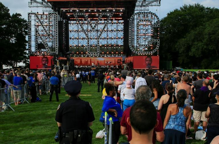 People streamed onto Central Park's Great Lawn Saturday afternoon, as the New York Philharmonic played rousing renditions of classics including 'New York, New York'