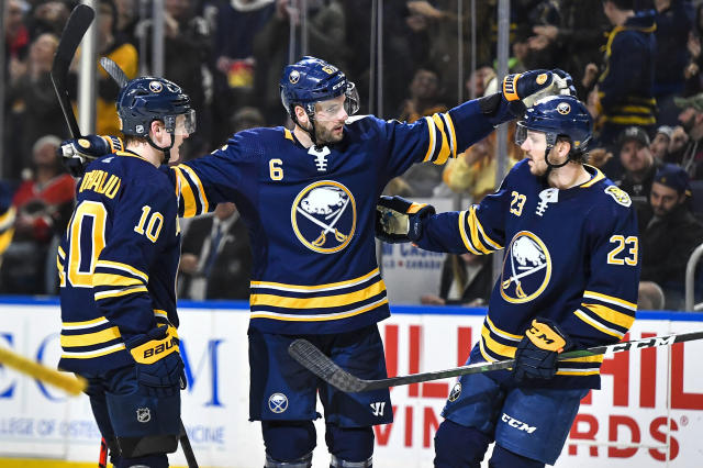Buffalo Sabres defenseman Marco Scandella (6) celebrates his goal with defenseman Henri Jokiharju (10) and center Sam Reinhart (23) during the second period of an NHL hockey game against the Los Angeles Kings in Buffalo, N.Y., Saturday, Nov. 21, 2019. (AP Photo/Adrian Kraus)