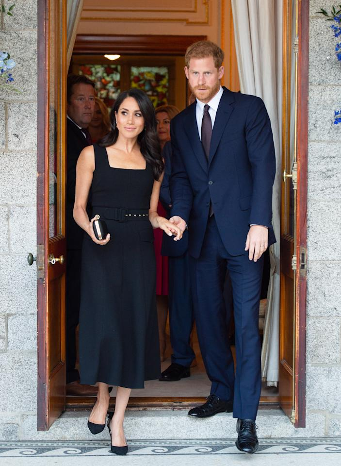 <p>Markle opted for a custom A-line black belted dress (approximately $3,000 CAD) by Emilia Wickstead to attend a summer garden party at Glencairn, the home of Britain's Ambassador to Ireland, Robin Barnett. Paired with a satin clutch by Gucci (approximately $3,000 CAD) and Aquazurra's Deneuve Bow pumps ($1,033.81 CAD), Markle let her hair down for a soft, romantic look. </p>