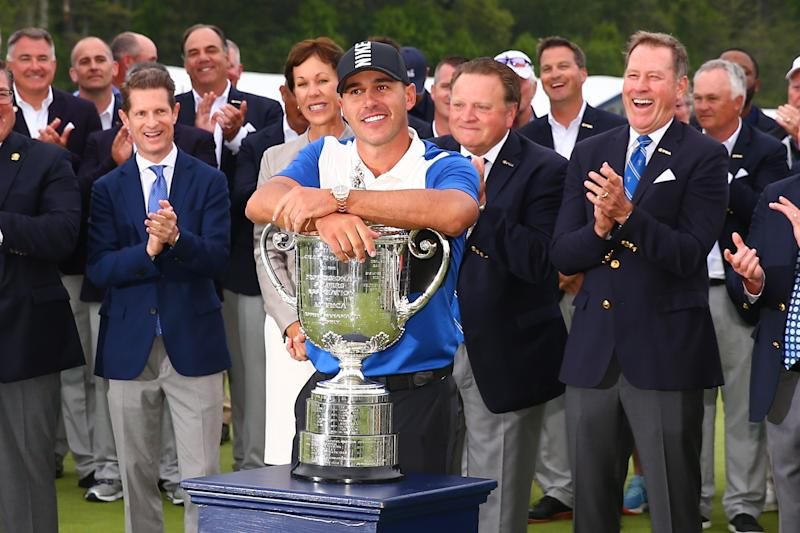 FARMINGDALE, NY - MAY 19: Brooks Koepka of the United States leans on the Wanamaker Trophy after winning the 2019 PGA Championship at the Bethpage Black course with a score of 8 under par on May 19, 2019 in Farmingdale, New York.(Photo by Rich Graessle/Icon Sportswire via Getty Images)