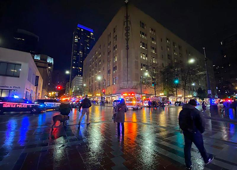 A gunman opened fire in downtown Seattle on Wednesday night, killing at least one person and injuring seven others, authorities said.