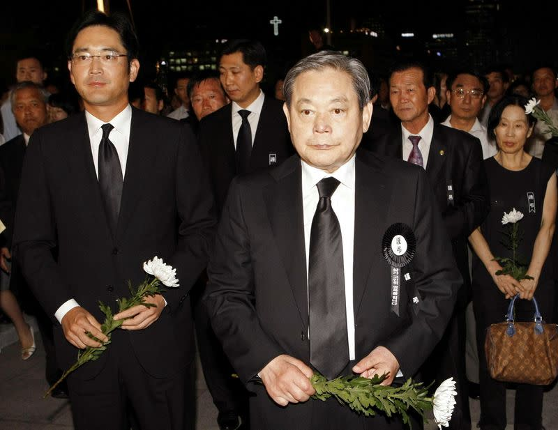 FILE PHOTO: Lee, former Samsung Group chairman, and his son Lee Jae-yong wait to make a call of condolence for the late President Kim at a memorial altar at the National Assembly in Seoul