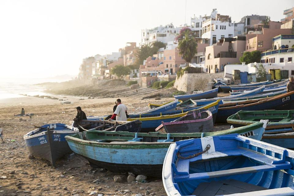 <p>The clay-baked fishing village of Taghazout has quickly earned a reputation as one of the top surf towns in the world. After morning prayers each day, fishermen in blue wooden boats head out to sea to collect fish to sell at the thriving markets while young surfers gather on shore to before catching the waves. </p><p>This laidback spirit can be seen in the stylish cafes and small shops offering Moroccan goods throughout the city. Helpful tip: make sure to bring cash as there are no ATMs within the small town. </p>