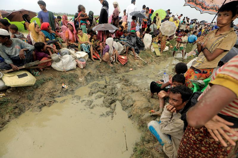 Rohingya refugees who fled from Myanmar wait to be let into Bangladesh on Oct. 16. (Zohra Bensemra/Reuters)