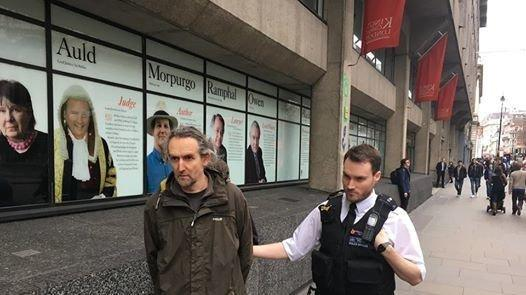 Roger Hallam, who has been on hunger strike for 11 days, being arrested following a peaceful protest outside the university: King's College Climate Emergency