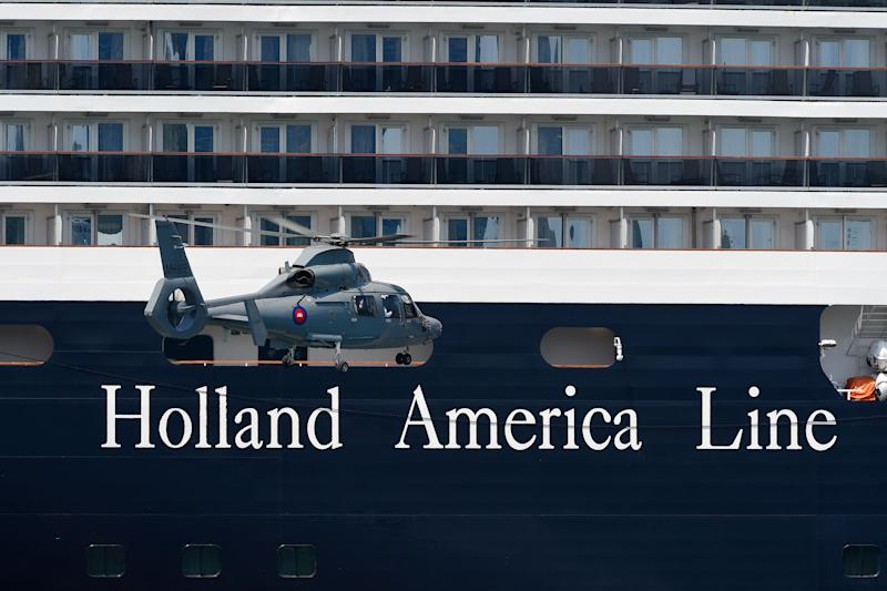 A helicopter approaches the Westerdam cruise ship