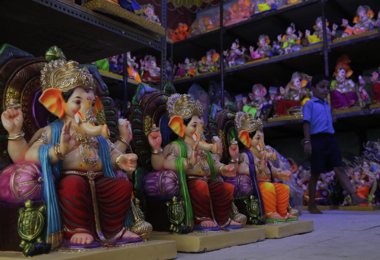 <p>Idols of Hindu god Ganesha stand on display at a studio in Mumbai, India, Wednesday, Aug. 29, 2018. The idols are being prepared for 'Ganesha Chaturthi' festival that celebrates the birth of the elephant headed god. (AP Photo/Rafiq Maqbool) </p>