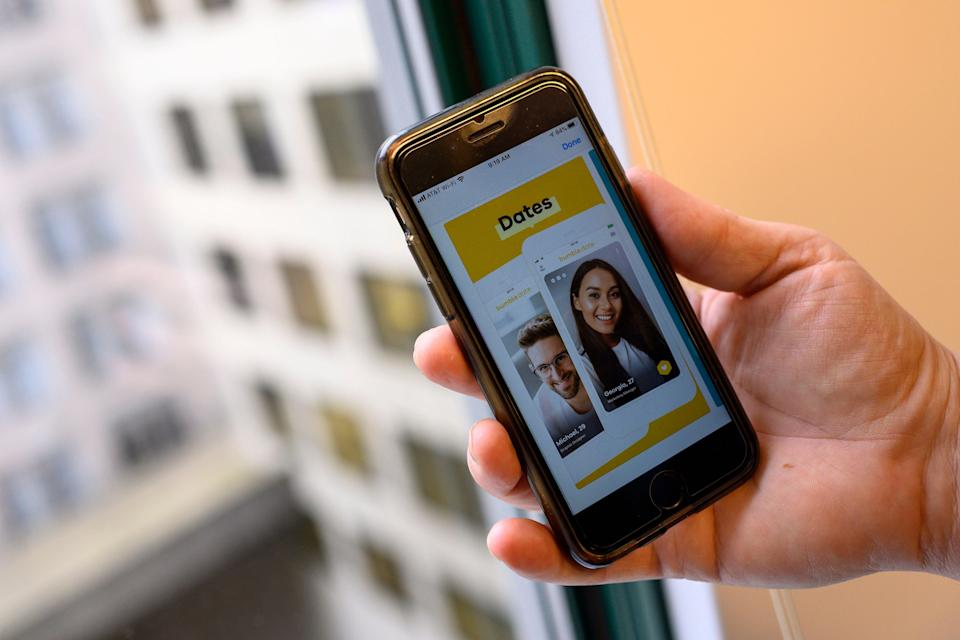 Employees of the popular dating app Bumble will receive a fully paid week off in June to avoid pandemic burnout. (AFP via Getty Images)