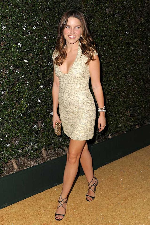 """One Tree Hill's"" Sophia Bush strutted her stuff in a sassy golden mini and strappy metallic footwear. Jordan Strauss/<a href=""http://www.wireimage.com"" target=""new"">WireImage.com</a> - January 5, 2011"