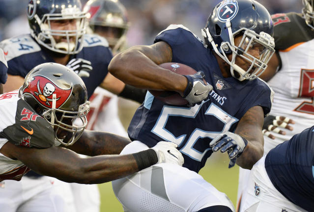 Tennessee Titans running back Derrick Henry (22) carries the ball past Tampa Bay Buccaneers defensive end Vinny Curry (97) in the first half of a preseason NFL football game Saturday, Aug. 18, 2018, in Nashville, Tenn. (AP Photo/Mark Zaleski)