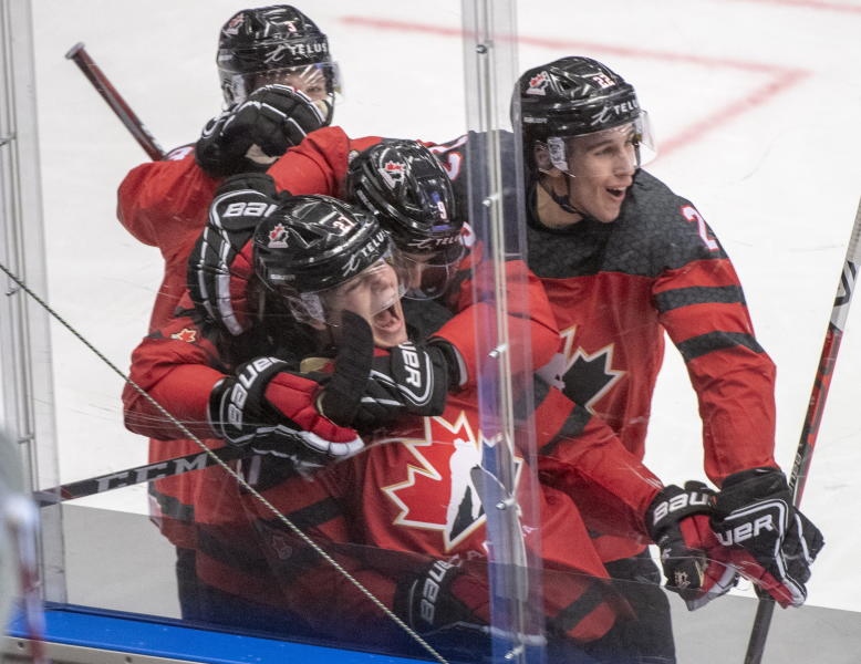 Team Canada's Barrett Hayton (27) celebrates with teammates after scoring a goal during third period action against the United States at the World Junior Hockey Championships in Ostrava, Czech Republic, Thursday, Dec. 26, 2019. (Ryan Remiorz/The Canadian Press via AP)