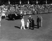 FILE - In this file photo dated Nov. 26, 1953, Britain's Queen Elizabeth II shakes hands with E.L. Allen, Minister of Education, at Sabina Park in Kingston, Jamaica, where the Queen and her husband, the Duke of Edinburgh greeted more than 2,000 school children lined up on the park's cricket field. The Duke, left, steps up to greet Mr. Allen as Harold Houghton, second from right, director of Education, and G.M. Dacosta, right, president of the Cricket Club, wait their turns to meet the royal couple. The Queen is the first British ruling monarch in history to visit the British rum and sugar colony. Man wearing plumed hat is not identified. Prince Philip who died Friday April 9, 2021, aged 99, lived through a tumultuous century of war and upheavals, but he helped forge a period of stability for the British monarchy under his wife, Queen Elizabeth II. Philip helped create the Commonwealth of nations, with the queen at its head, in an attempt to bind Britain and its former colonies together on a more equal footing. (AP Photo, FILE)