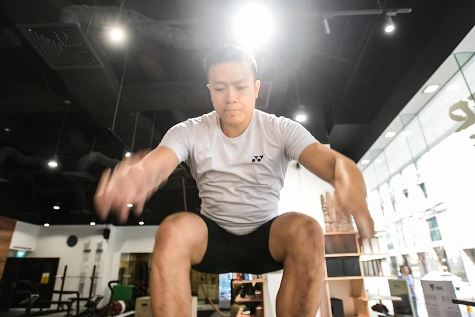 John Cheah uses his quad and lat muscles to achieve the explosiveness to lift the weights. (PHOTO: Stefanus Ian)