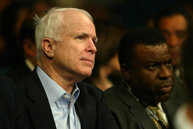 Sen. John McCain (L) watches the 2004 middleweight title bout in Las Vegas between Bernard Hopkins and Oscar De La Hoya along with former Nevada Athletic Commission chairman Luther Mack of Reno. (Getty Images)