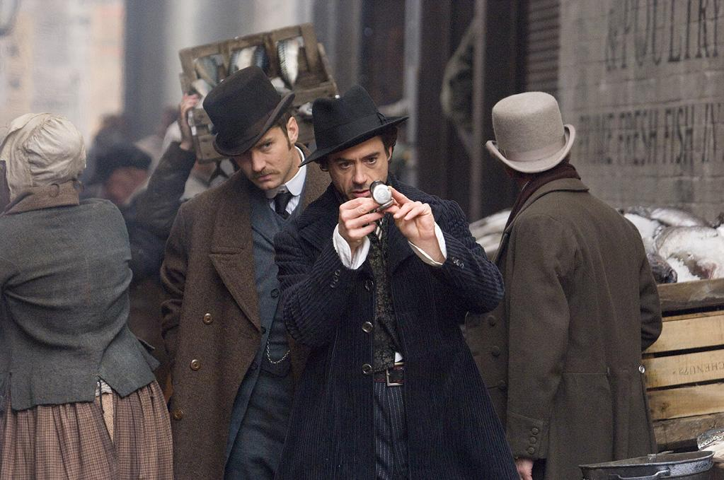 """<a href=""""http://movies.yahoo.com/movie/1810045845/info"""">SHERLOCK HOLMES</a> (2009)  Robert Downey Jr. and Jude Law recreated two of Sir Arthur Conan Doyle's most famous creations, Sherlock Holmes and Dr. Watson in director Guy Ritchie action adventure updating of the material.  <a href=""""http://www.hollywoodreporter.com/heat-vision/first-look-sherlock-holmes-a-209734"""" target=""""_blank"""">STORY: Robert Downey Jr. in 'Sherlock Holmes: A Game of Shadows' Posters</a>"""