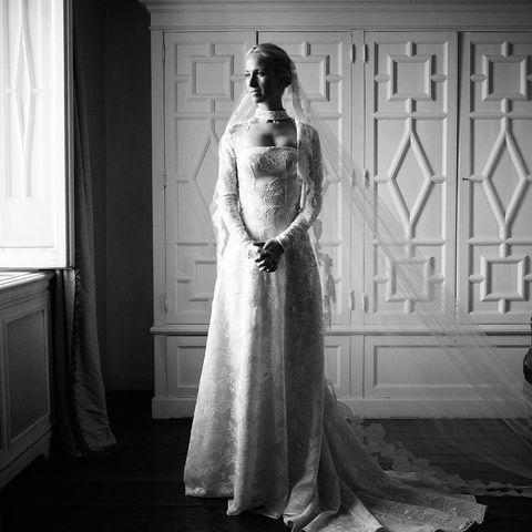 """<p>Meghan Markle's friend wed her energy entrepreneur husband Michael Hess last month wearing a bespoke wedding dress she designed herself. Posting a black and white image on Instagram of herself standing in the dress on her big day, the fashion designer explained she decided on hand embroidered guipure lace on laser cut silk organza embroidered by a Swiss family-run mill. </p><p>The dress was finished with a 10-metre-long silk tulle veil was embroidered with lace which was reminiscent of the Duchess of Sussex's symbolic veil she wore to her royal wedding in May 2018. The mother-of-one's 16-foot veil was with embroidered flowers from all of the countries in the British Commonwealth. <br></p><p><a href=""""https://www.instagram.com/p/B298ZZ3Bkqm/"""" rel=""""nofollow noopener"""" target=""""_blank"""" data-ylk=""""slk:See the original post on Instagram"""" class=""""link rapid-noclick-resp"""">See the original post on Instagram</a></p>"""