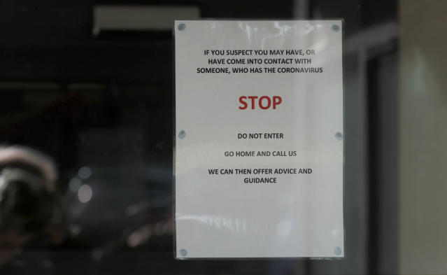 A sign at the entrance of the County Oak Medical Centre GP practice in Brighton (PA)