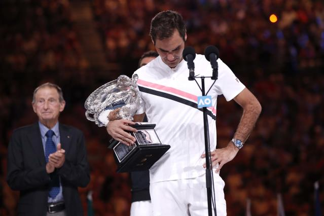 Tennis - Australian Open - Men's singles final - Rod Laver Arena, Melbourne, Australia, January 28, 2018. Switzerland's Roger Federer celebrates with the trophy after winning the final against Croatia's Marin Cilic. REUTERS/Issei Kato