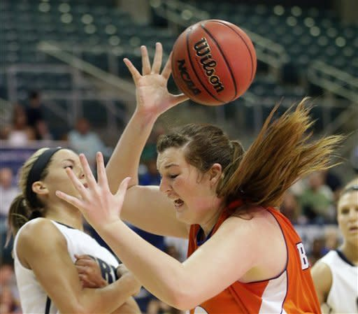 Sam Houston State's Angela Beadle, front right, loses the ball as Oral Roberts' Kevi Luper, left, defends during the second half of the Southland Conference championship basketball game on Saturday, March 16, 2013, in Katy, Texas. Oral Roberts defeated Sam Houston State 72-66. (AP Photo/David J. Phillip)