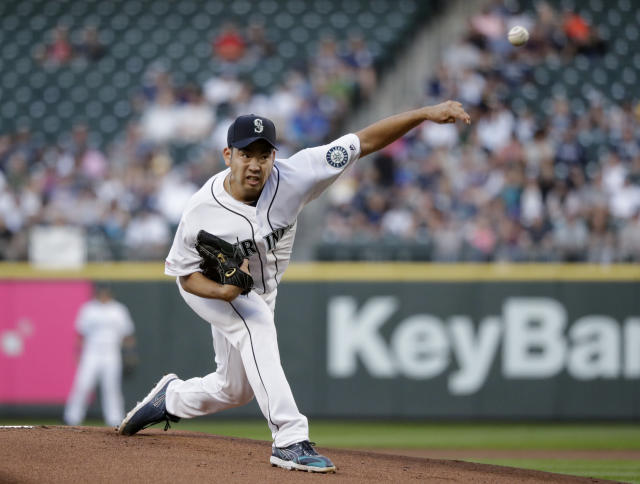 Seattle Mariners starting pitcher Yusei Kikuchi throws to a New York Yankees batter during the first inning of a baseball game Tuesday, Aug. 27, 2019, in Seattle. (AP Photo/Elaine Thompson)