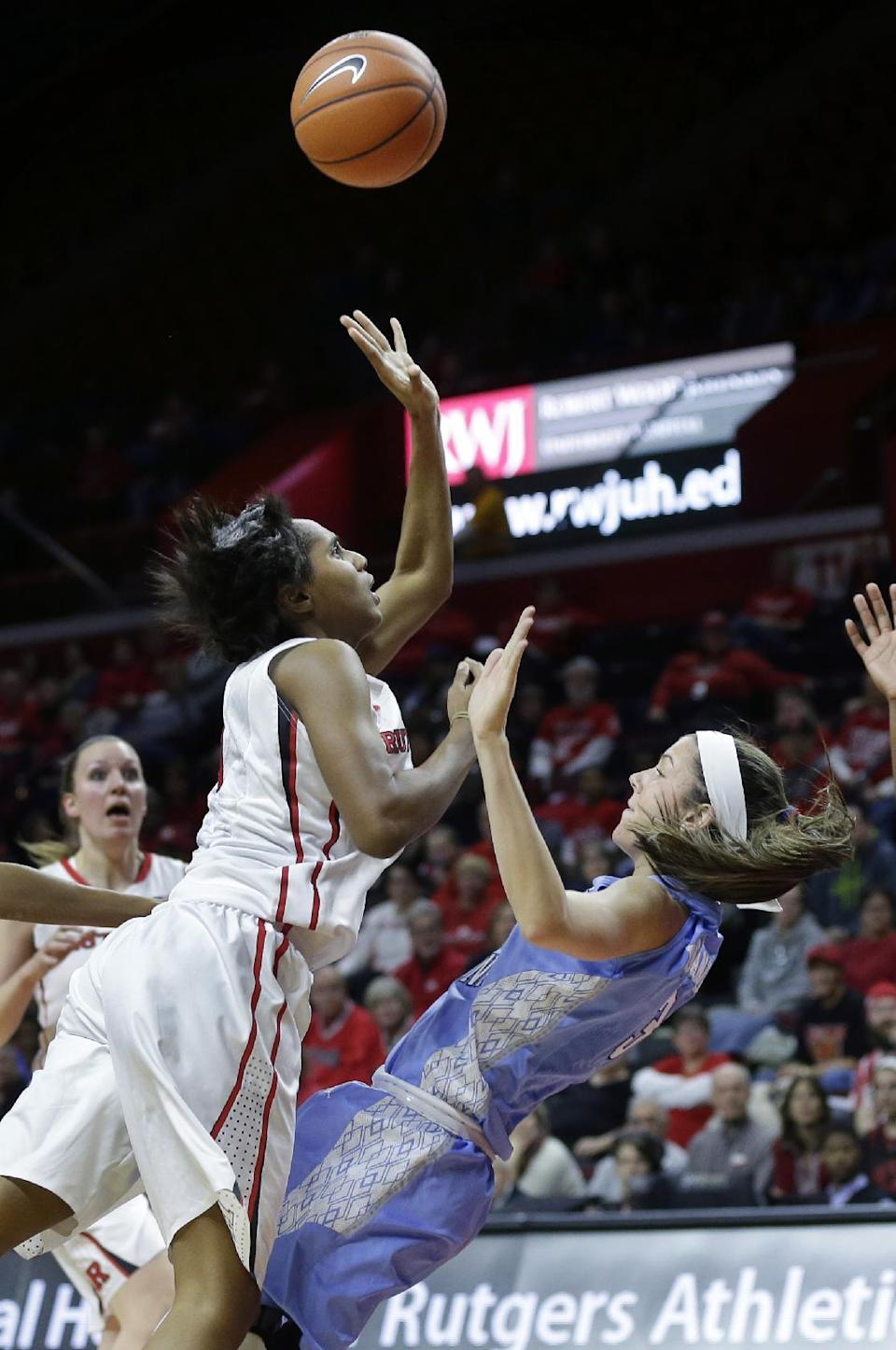 Rutgers' Tyler Scaife, front left, shoots as she collides with North Carolina's Megan Buckland during the first half of an NCAA college basketball game Thursday, Dec. 4, 2014, in Piscataway, N.J. (AP Photo/Mel Evans)