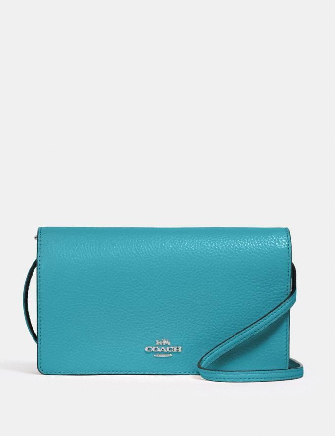 Anna Foldover Crossbody Clutch. Image via Coach.