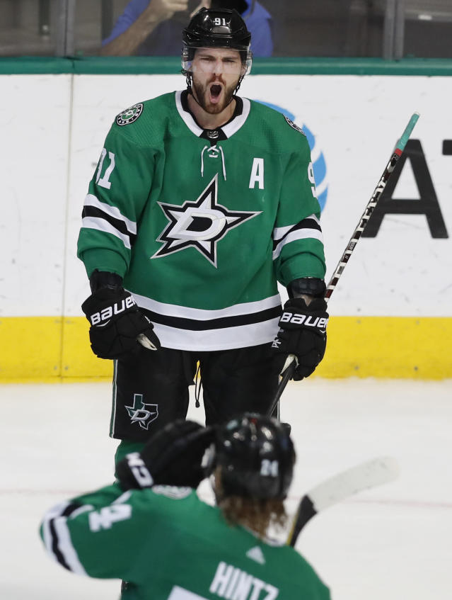 Dallas Stars center Tyler Seguin (91) yells after scoring a goal as teammate Roope Hintz (24) looks on during the second period of an NHL hockey game against the Nashville Predators in Dallas, Tuesday, Feb. 19, 2019. (AP Photo/LM Otero)