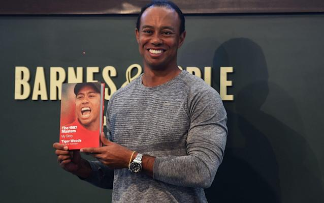 <span>Tiger Woods is promoting a book about his 1997 Masters victory</span> <span>Credit: AFP </span>