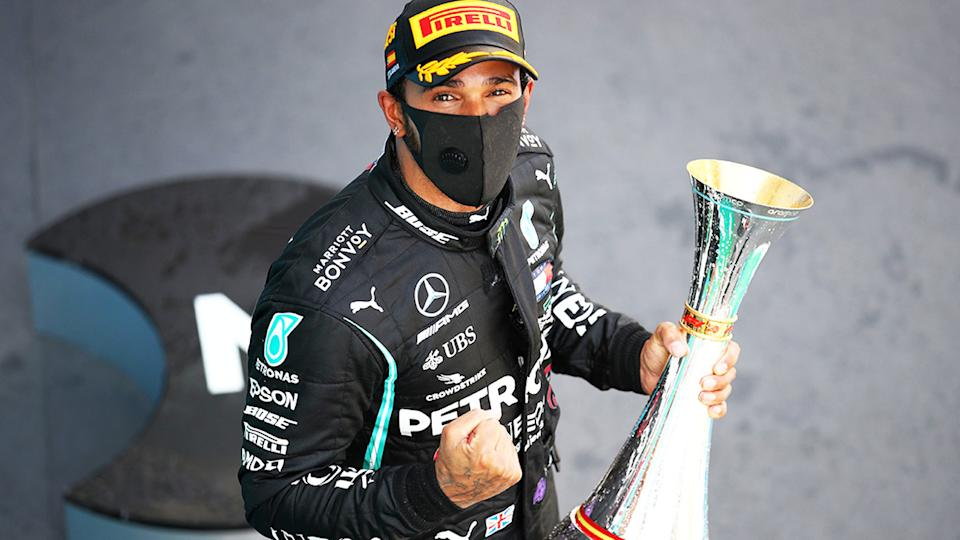 Lewis Hamilton, pictured here celebrating on the podium after winning the Spanish Grand Prix.