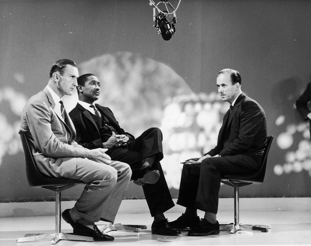 27th August 1963:  England cricket captain, Ted Dexter (left) with West Indies captain Frank Worrell (1924 - 1967), on the BBC 'Sportsview' programme, presented by Peter West (right). The captains are to give their views on the recent test series between the two countries, which the West Indies won 3-2.  (Photo by Harry Todd/Fox Photos/Getty Images)