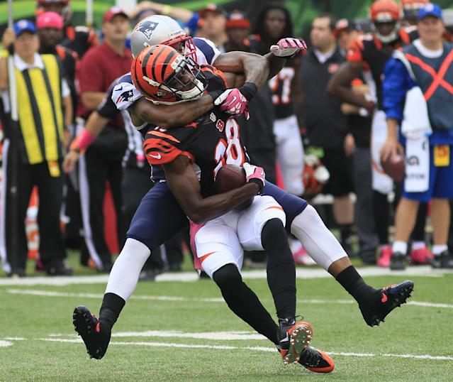 Cincinnati Bengals wide receiver A.J. Green (18) is tackled by New England Patriots cornerback Aqib Talib in the first half of an NFL football game, Sunday, Oct. 6, 2013, in Cincinnati. (AP Photo/Tom Uhlman)