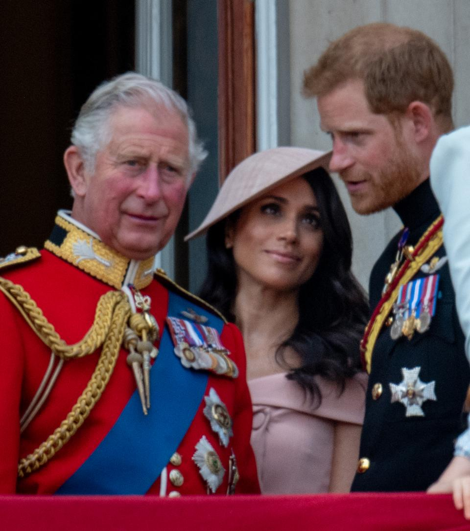 Prince Charles, Prince of Wales with Prince Harry, Duke of Sussex and Meghan, Duchess of Sussex during Trooping The Colour 2018 on June 9, 2018 in London, England.