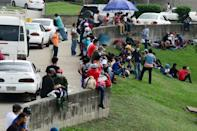 People gather for a migrant caravan on January 14, 2021 before setting out from San Pedro Sula, Honduras with the aim of making it to the United States