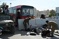 Taliban officials were ordering those destined for evacuation to leave their bags behind on the instruction of US troops, they said, but people were allowed to remove their valuables (AFP/WAKIL KOHSAR)
