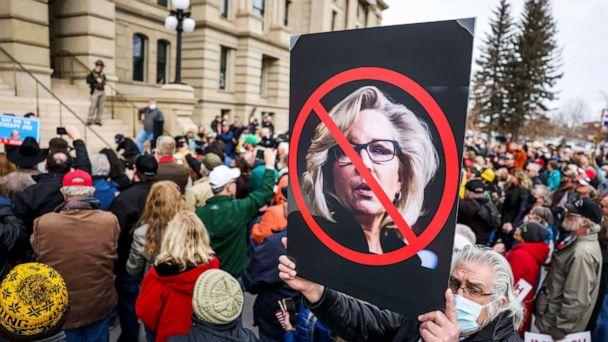 PHOTO: A sign against Rep. Liz Cheney is held up in the crowd as Rep. Matt Gaetz speaks during a rally against her in Cheyenne, Wyo., Jan. 28, 2021. (Michael Ciaglo/Getty Images)