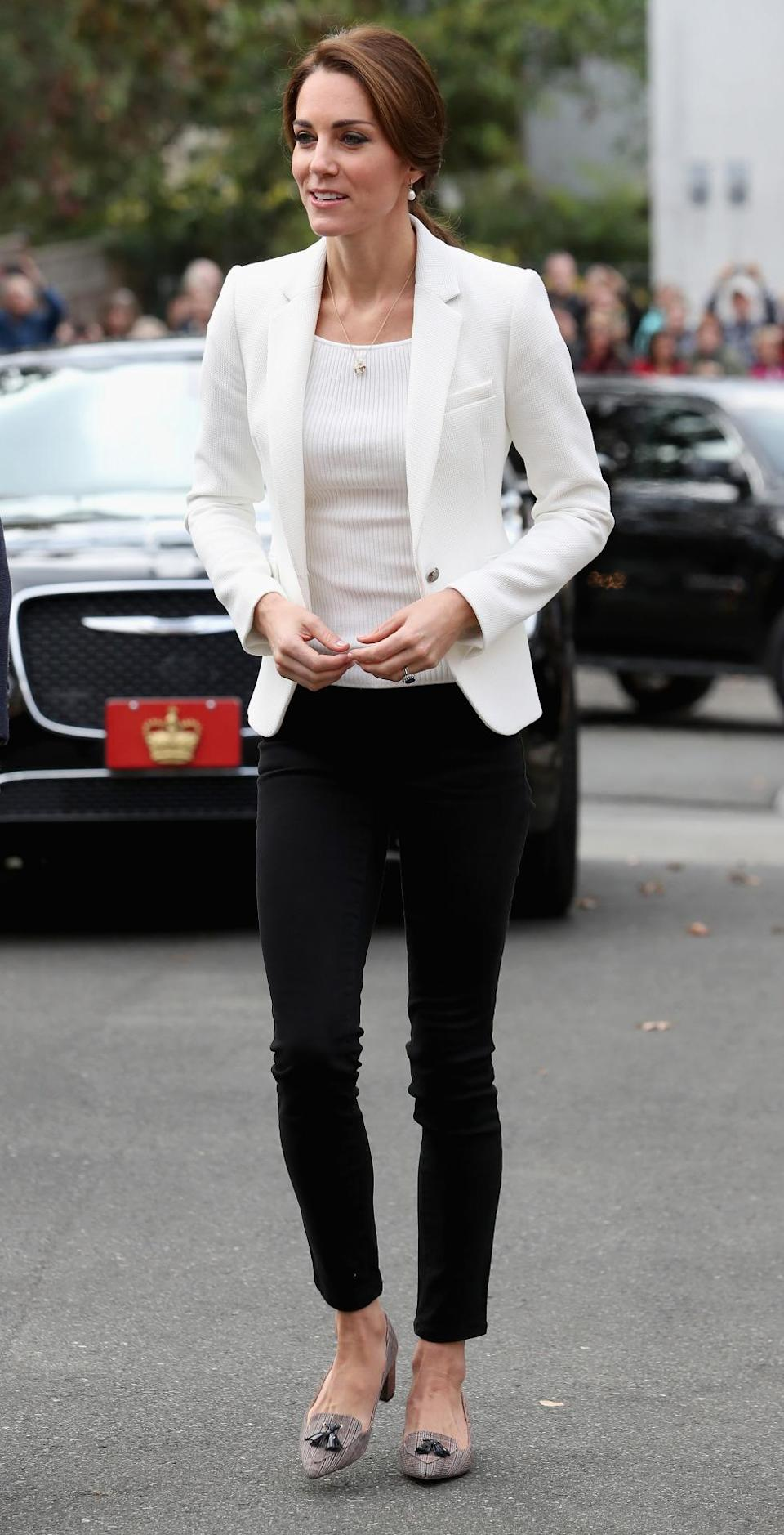 <p>Kate donned a chic white blazer from Zara with a H&M top underneath for a day of engagements in Victoria, Canada. Black Zara trousers and tweed J Crew heels (which are now completely sold out) topped off the look. </p><p><i>[Photo: PA]</i> </p>
