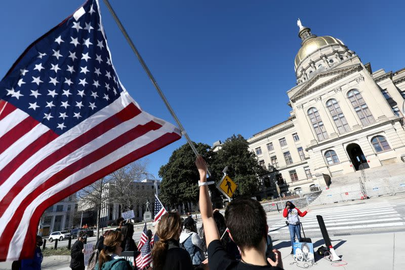 FILE PHOTO: Protesters rally against voting restrictions in U.S. state of Georgia