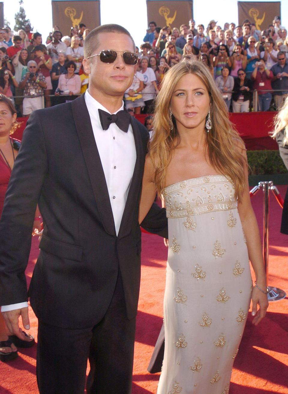 """<p>Pitt and Aniston officially split, offering the below joint <a href=""""http://people.com/archive/cover-story-heartbreaker-vol-63-no-3/"""" rel=""""nofollow noopener"""" target=""""_blank"""" data-ylk=""""slk:statement"""" class=""""link rapid-noclick-resp"""">statement</a>:</p><p>""""We would like to announce that after seven years together we have decided to formally separate. For those who follow these sorts of things, we would like to explain that our separation is not the result of any of the speculation reported by the tabloid media. This decision is the result of much thoughtful consideration. We happily remain committed and caring friends with great love and admiration for one another. We ask in advance for your kindness and sensitivity in the coming months.""""</p>"""