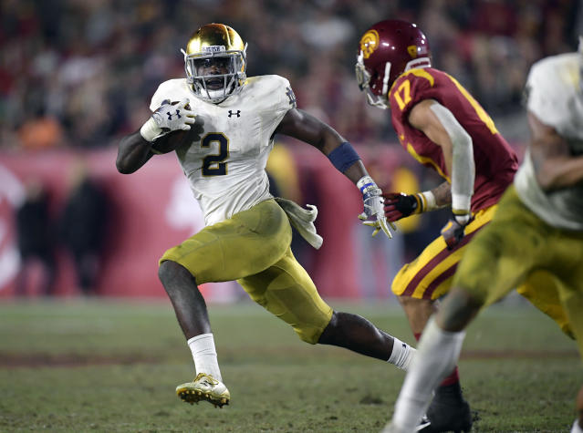 FILE - In this Nov. 24, 2018, file photo, Notre Dame running back Dexter Williams, left, carries the ball as Southern California cornerback Chase Williams defends during the second half of an NCAA college football game in Los Angeles. No. 2 Clemson plays No. 3 Notre Dame in the Cotton Bowl on Dec. 29, 2018. (AP Photo/Mark J. Terrill, File)